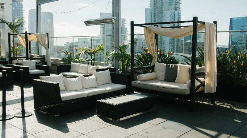 sofas on rooftop shared apartment amenity
