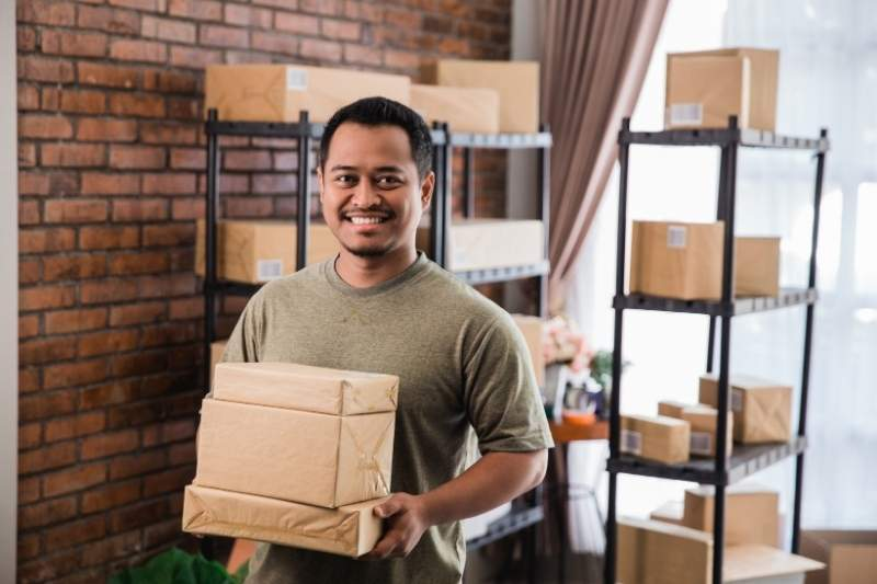 man in multifamily package room