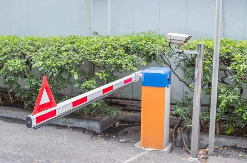 gate barrier arm to reduce tailgating at gated community