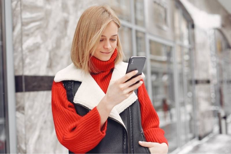 millennial using video intercom for condo with smartphone