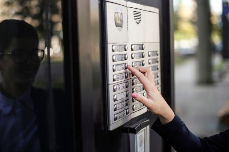 visitor using telephone entry system